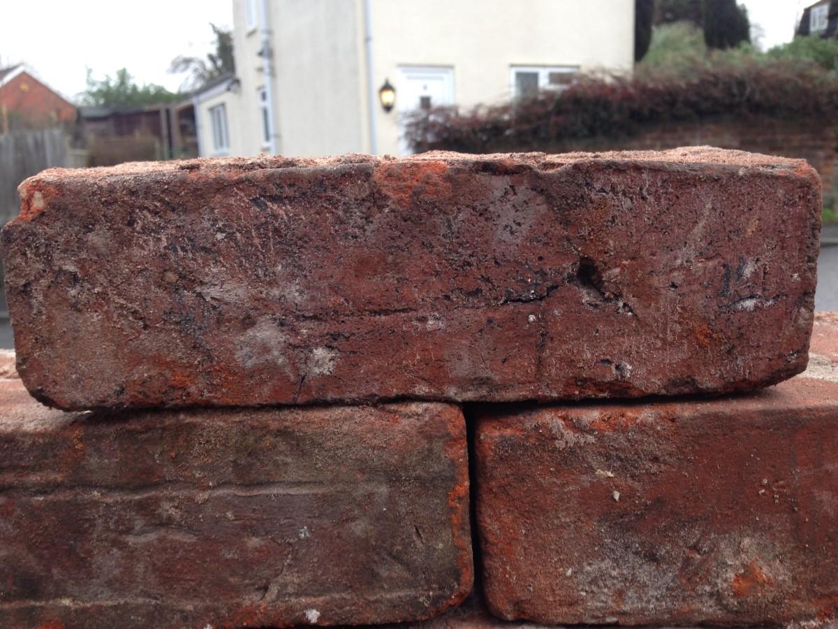Dark red to orange mixed secondhand handmade bricks for sale