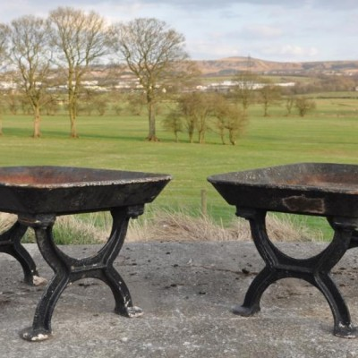 pair of unusual antique cast iron troughs planters on stands