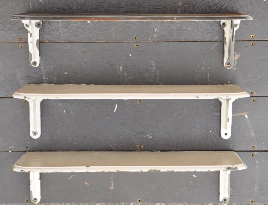 set of antique cast iron shelves