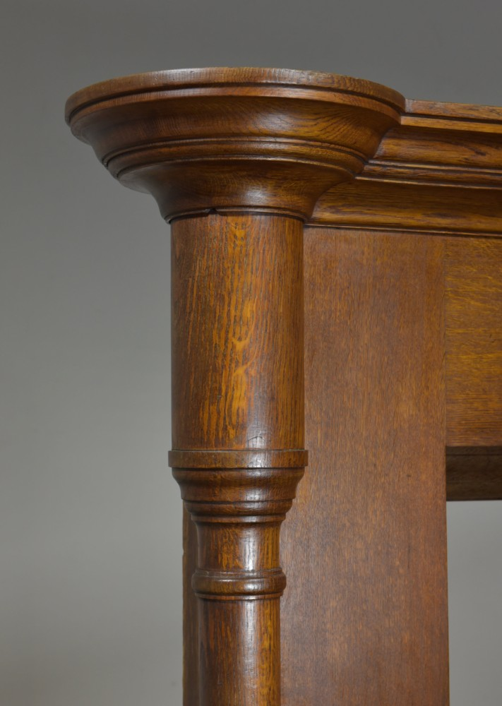 Large antique oak columned fire surround