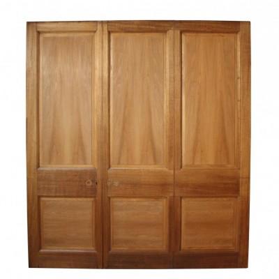 A reclaimed mid 20thC hardwood room divider