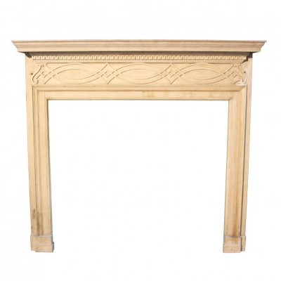A late 19thC carved timber fireplace