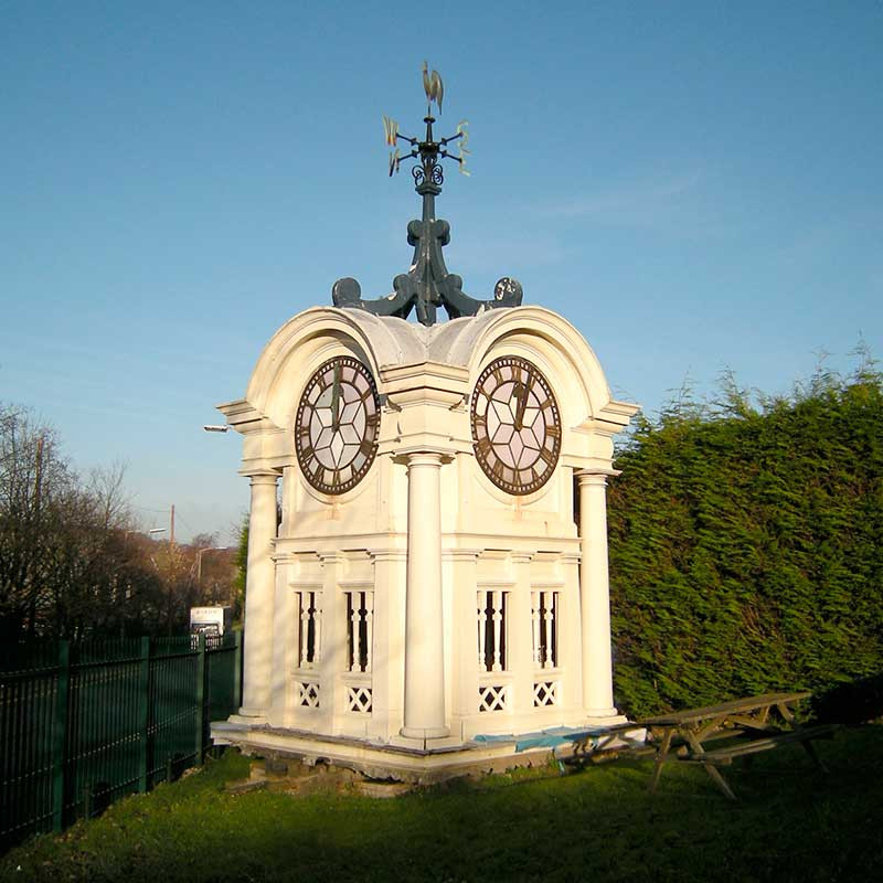 Restored 30ft high Victorian timber four-faced clock tower