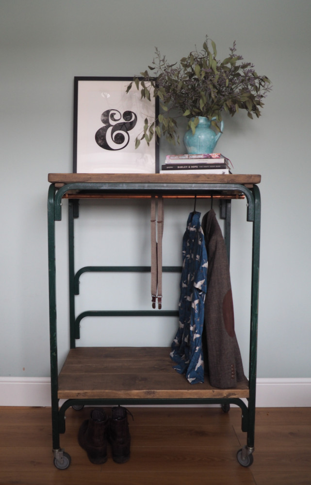 Vintage green Industrial trolley clothes rail and display space.