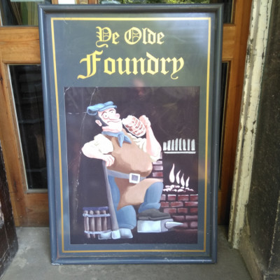 Large metal pub sign