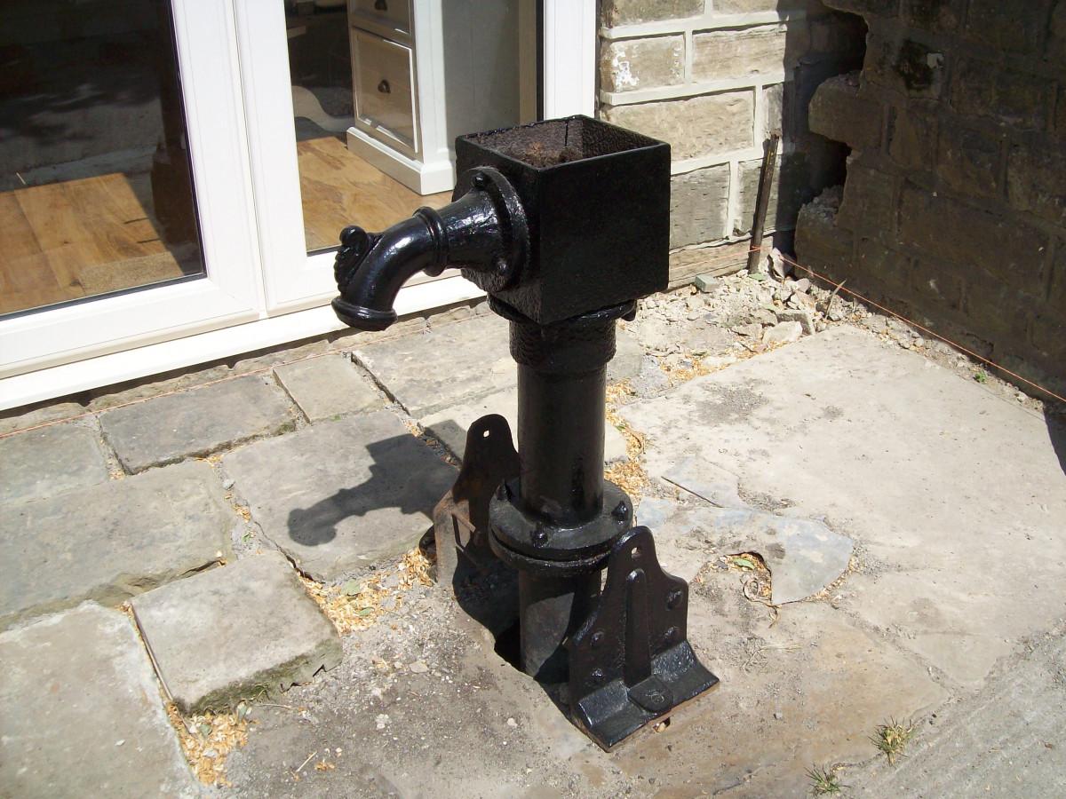 vintage hand water pump