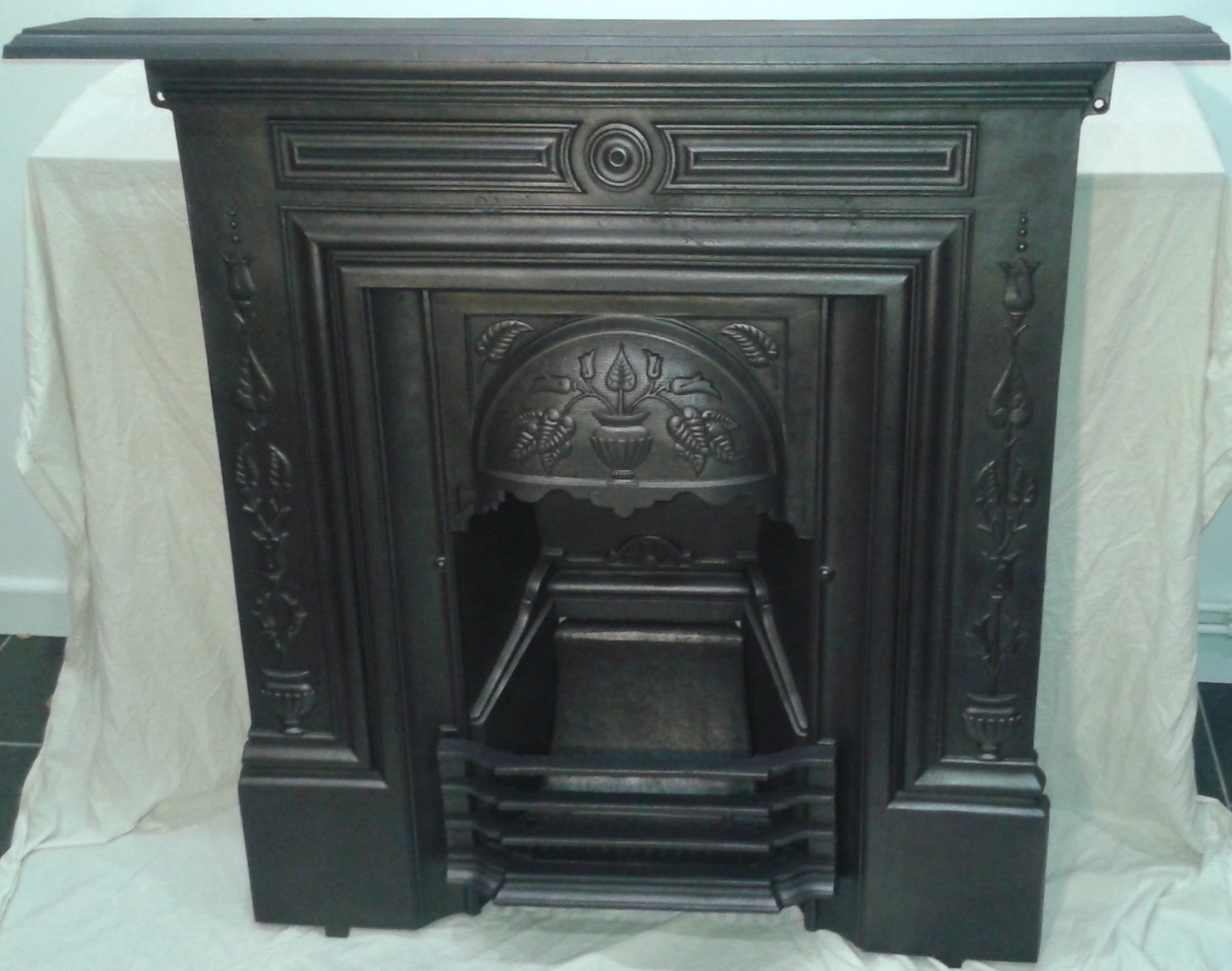 Late Victorian 36″ art nouveau cast iron fireplace.