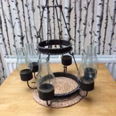 Iron chandelier with six candle holders and glass chimneys