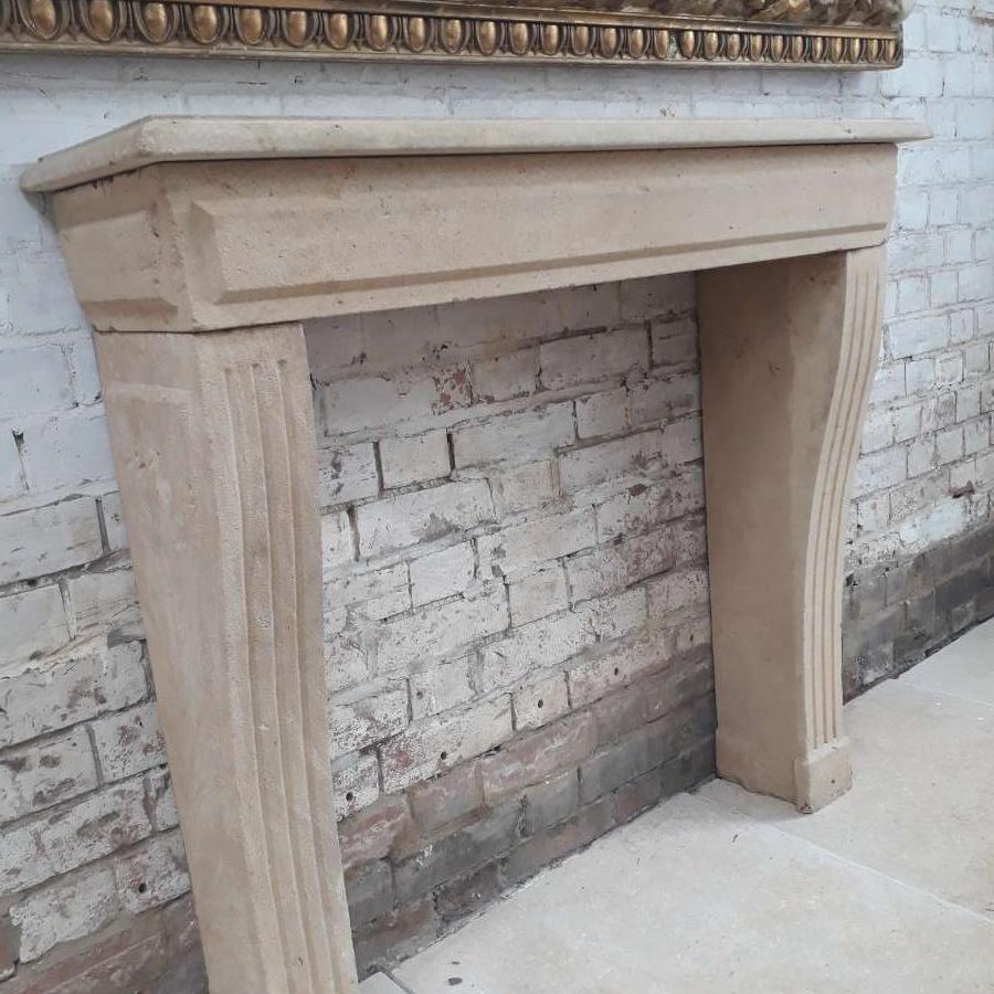 Antique stone fire place chimneypiece