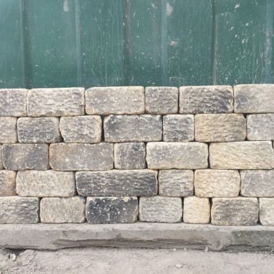 Punch faced walling stone