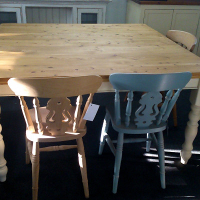 Old pine 5ft x 5ft square table on painted turned legs.