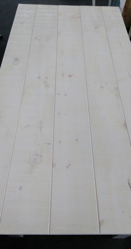 sawn rustic pine plank-top finish.