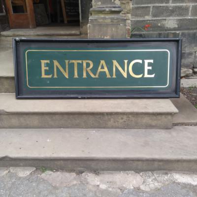 Metal pub entrance sign