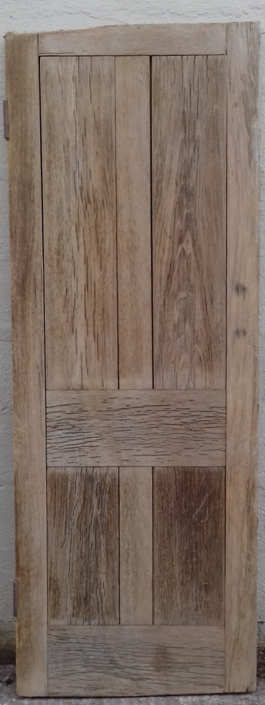 A very heavy early 20th century solid oak door with full thickness panels.