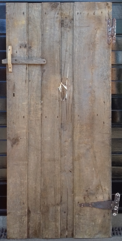 Early  ledged oak door with original hinges & oak latch.
