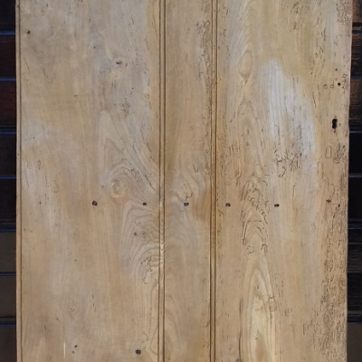 An early beaded 3 plank ledged elm door with original T-hinges.