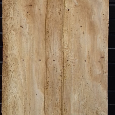 An early beaded 3 plank ledged elm door with original hinges.