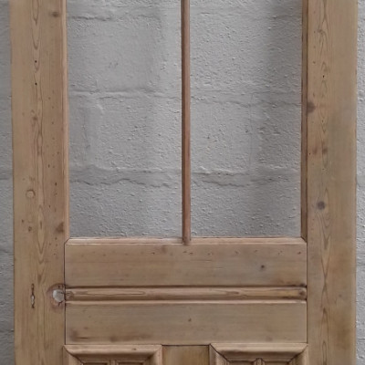 Victorian pine door currently unglazed.