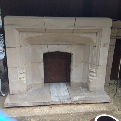 Reclaimed Gothic Style Arched Stone Fireplace