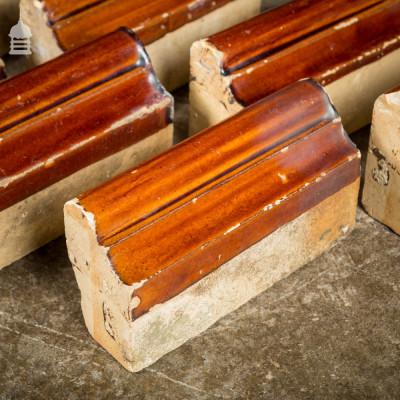 Set of 11 Brown Glazed Decorative Header Border Bricks