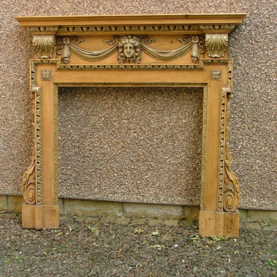 A carved pine and gesso/compo in the manner of William Kent