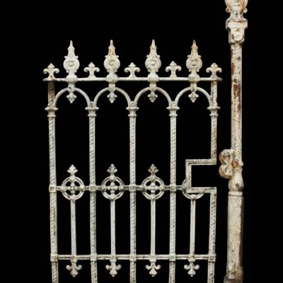 An antique cast iron pedestrian / side gate with post