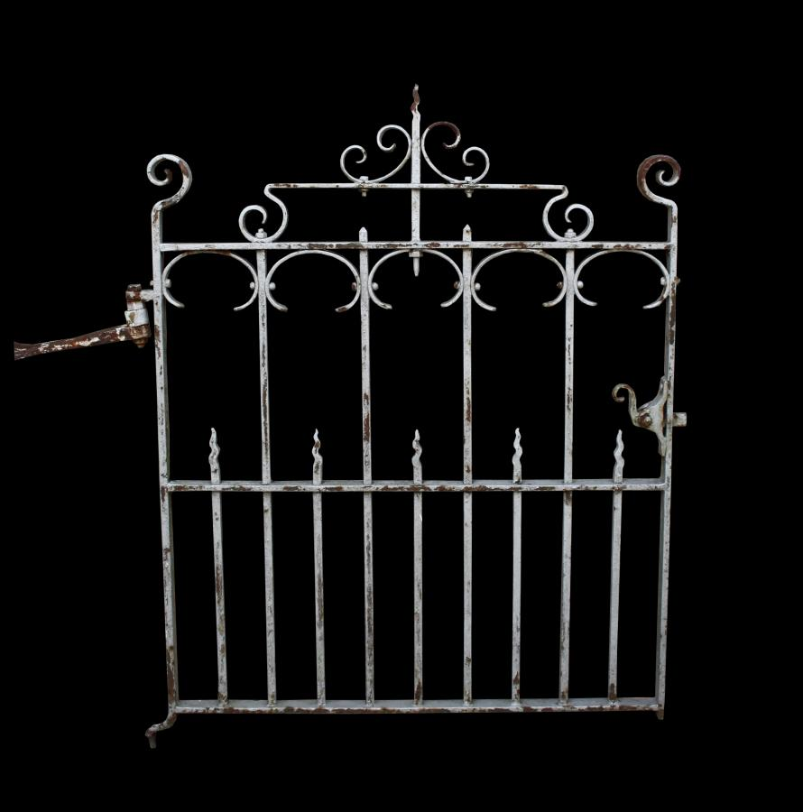 An antique wrought iron pedestrian / side gate