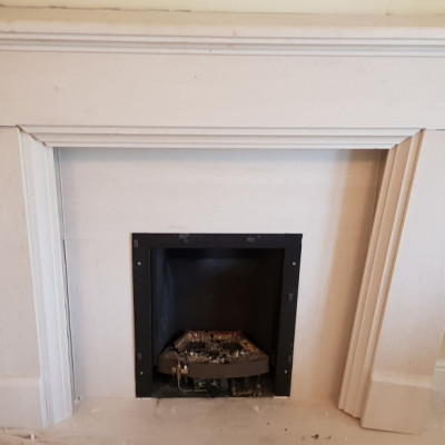 Polished Stone Fireplace and surrounding