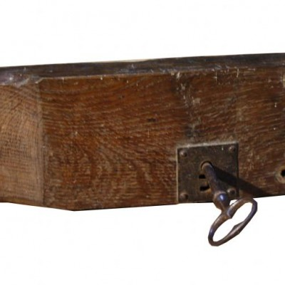 An 18th C. shaped oak rim lock with key