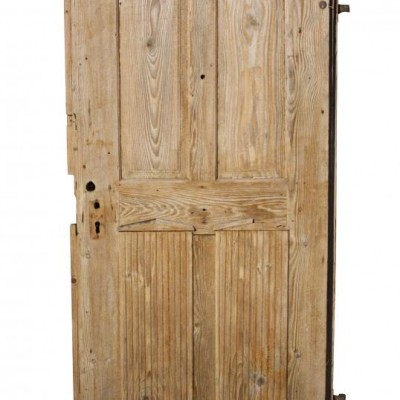A rustic French antique pine front door