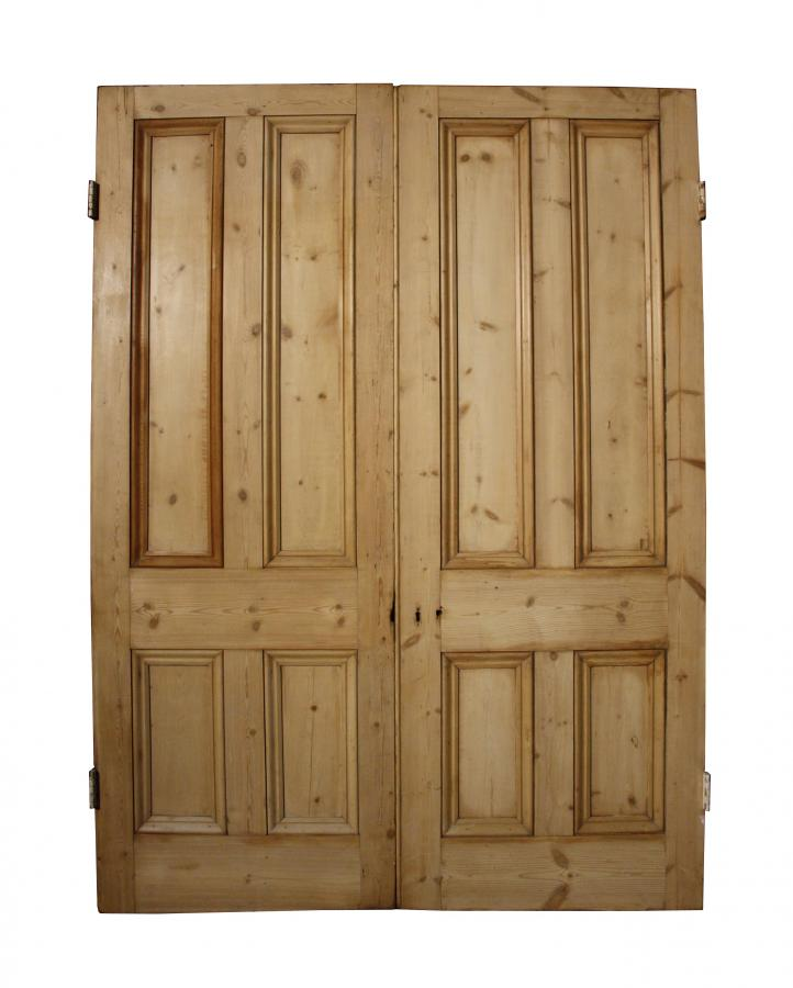 A pair of Victorian four panel pine double doors / room dividers