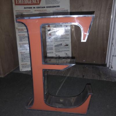 Large metal letter E