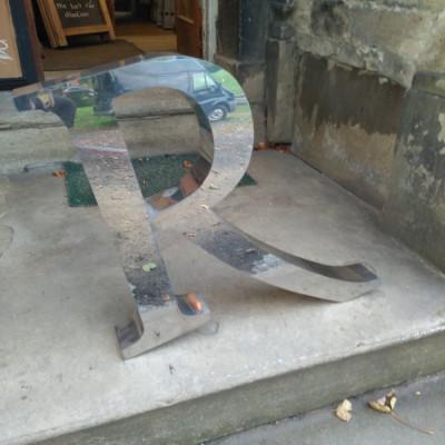 Large metal letter R