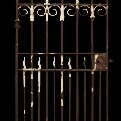 An antique wrought iron side gate