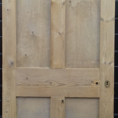 Reclaimed 4 paneled door with no mouldings to the panels.