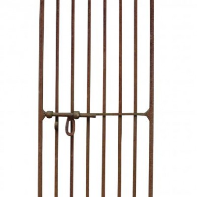 A heavy wrought iron side gate