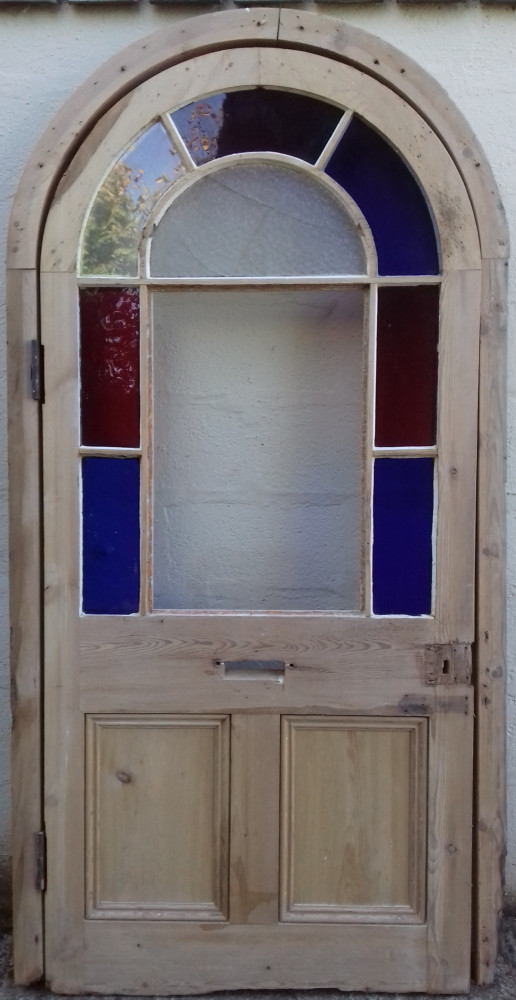 Victorian arched glazed door with frame