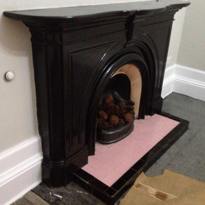 Stunning Antique Victorian black marble fireplace with arched aperture, original cast iron grate, and nicely fitted insert