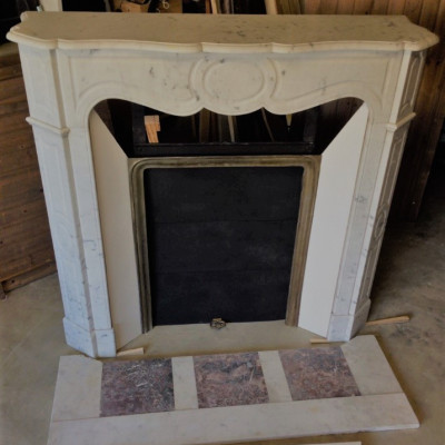 Two similar white marble Pompadour French fireplaces
