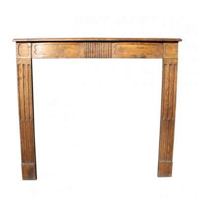 A late 18th C. French oak fire surround