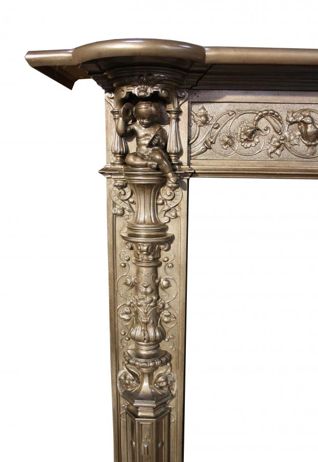 Ornate cast iron fire surround in the Renaissance revival manner