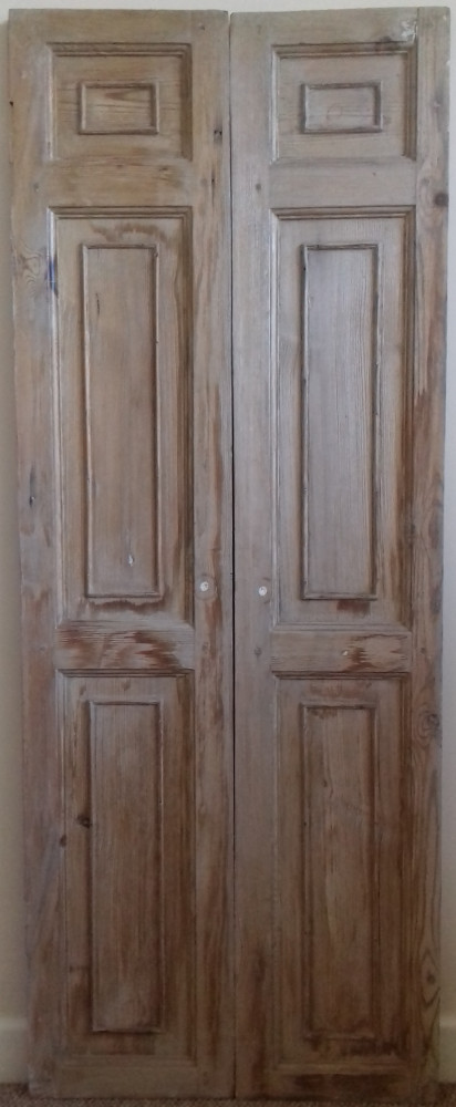 A pair of Georgian cupboard doors / outer window shutter leaves.