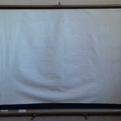 A vintage portable projector screen