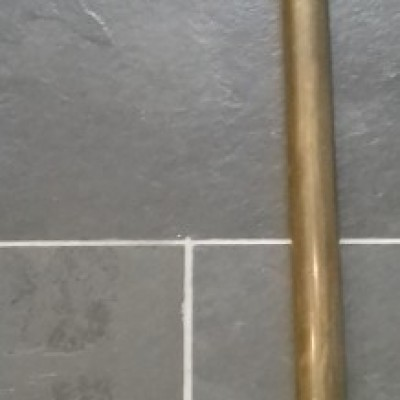 Reclaimed brass high level cistern flush pipe.