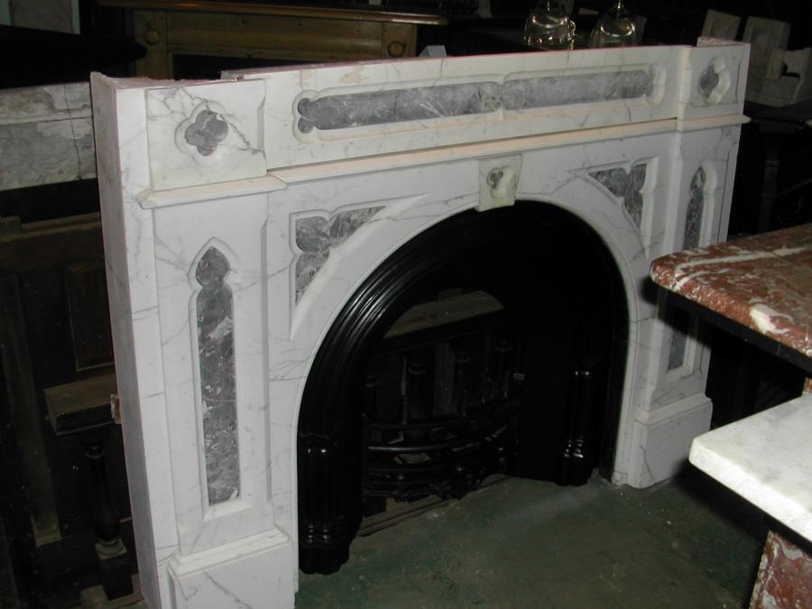 Victorian gothic arched marble fireplace.