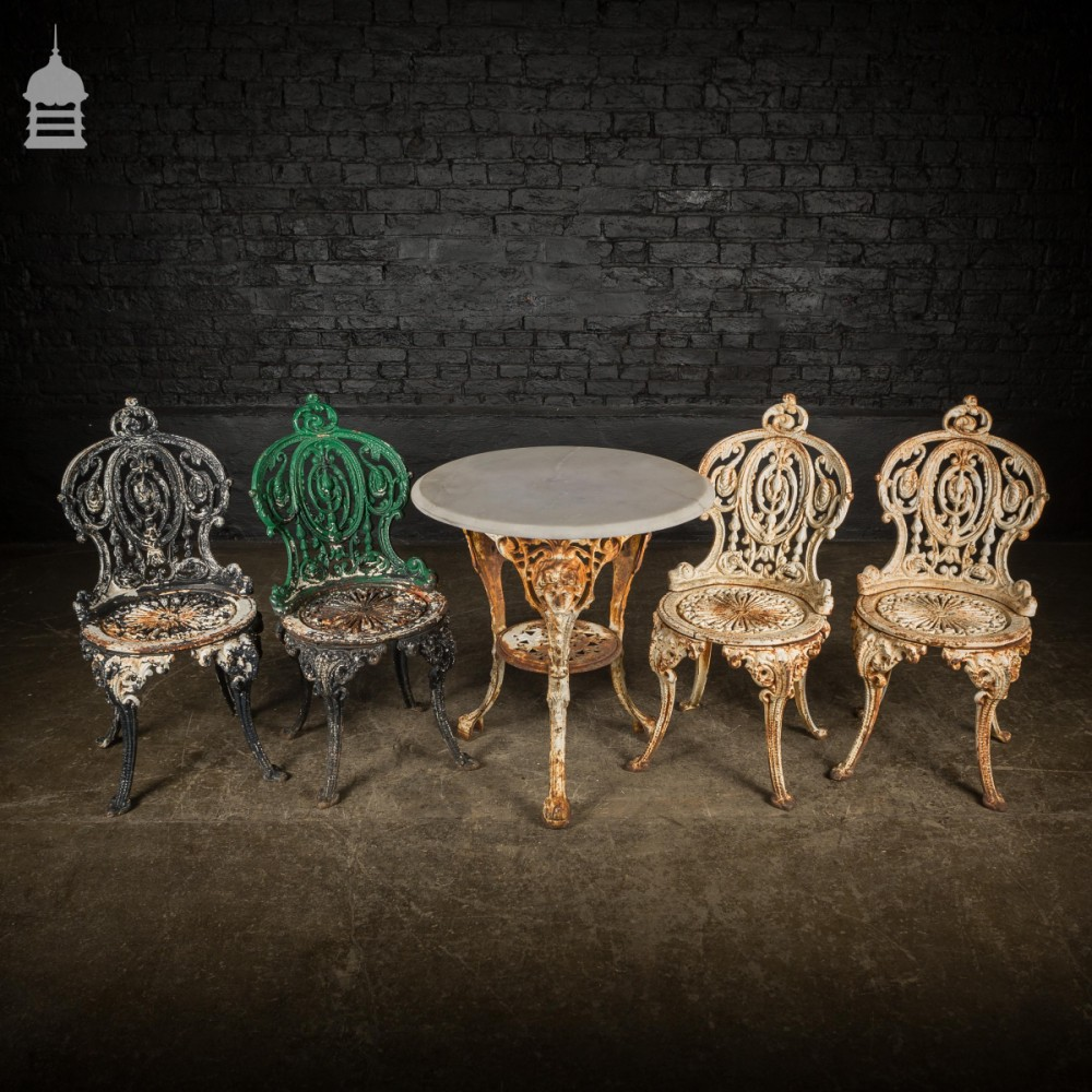 Victorian cast iron garden table set with marble top and 4 chairs