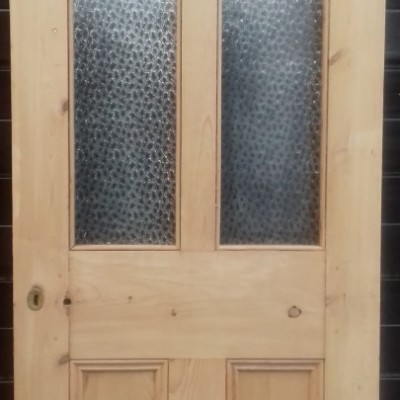 "Victorian  part glazed pine door with original ""daisy"" glass."