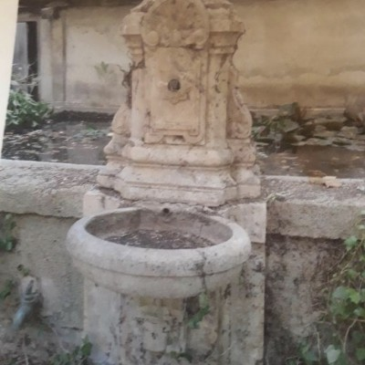 antique-carved-stone-wall-fountain-1.jpeg