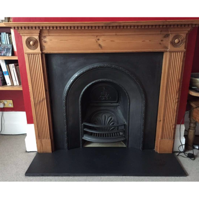 Victorian style cast iron fireplace and solid timber surround.