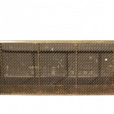An antique nursery fireplace fender
